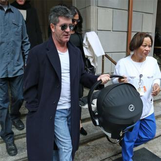 Simon Cowell Takes Son Home