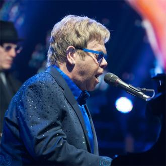 Elton John Says Son Elijah Is A Big Boy
