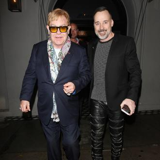 Elton John is better person now