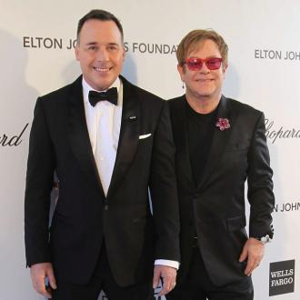 Sir Elton John Shows Off Son At Oscars After-party