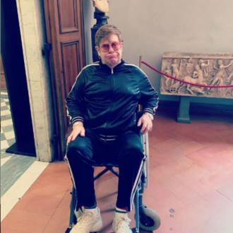 Sir Elton John sprains ankle