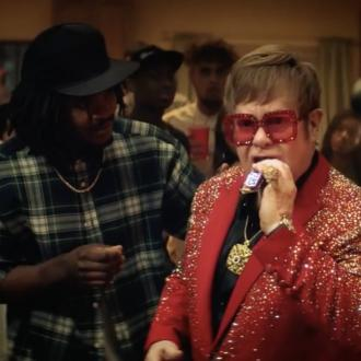 Sir Elton John Takes On Rap Battle For Snickers Ad