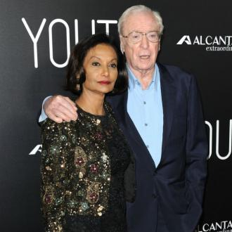 Michael Caine takes wife everywhere to avoid temptation