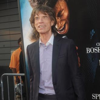Mick Jagger congratulated by L'Wren Scott's brother