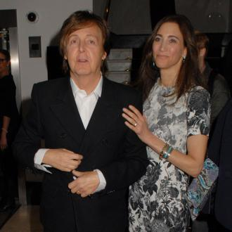 Sir Paul McCartney parties with wife