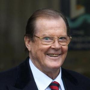 Sir Roger Moore Beaten Up By Former Wives