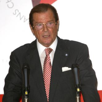 Sir Roger Moore honoured with PETA Person of the Year Award