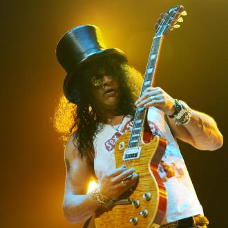 Slash 'claims he wasn't married to Perla'