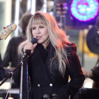 Stevie Nicks burned hole in nose?