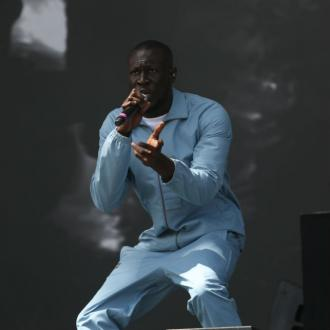 Stormzy won't mark success until friends are millionaires