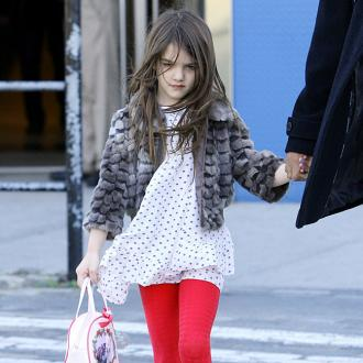 Suri Cruise Breaks Arm