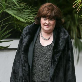 Susan Boyle takes flying lessons