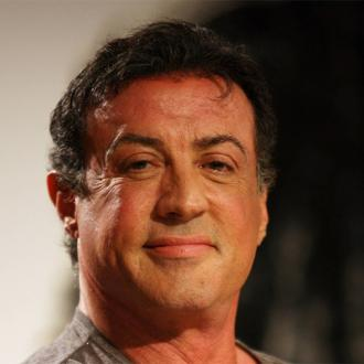 Stallone Reveals He Has A Tattoo Mural To Cover Injuries