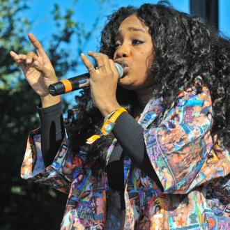 Sza Is Empowered By Nostalgic Overalls
