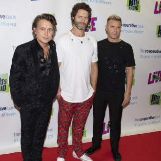 Take That are 'desperate' to hit the road again as soon as it's safe for fans