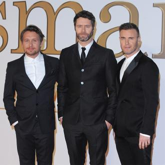 Take That want to write Bond song