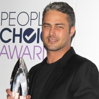 Taylor Kinney falls in love with someone's 'energy'