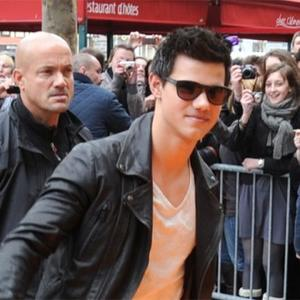 Taylor Lautner Covers Up