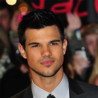 Taylor Lautner Celebrates With Kristen Stewart