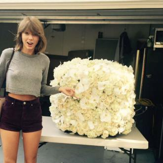 Taylor Swift Receives 'Coolest Flowers' From Kanye West