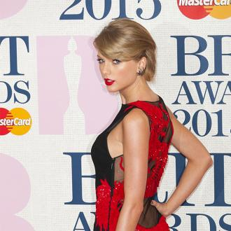 Taylor Swift wears dragon dress to BRITs