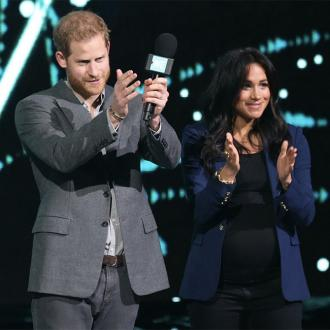 Duchess Meghan Makes Surprise Appearance With Prince Harry At We Day