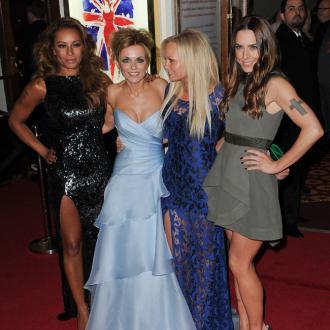 Spice Girls giggle together