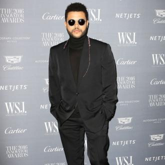 The Weeknd kisses Bella Hadid before dinner date