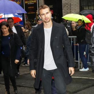 Theo James insures his butt