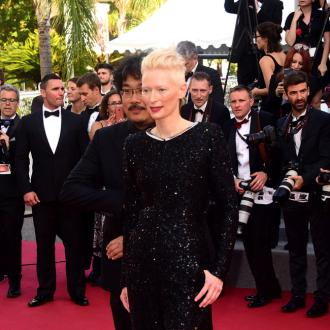Tilda Swinton laughing at new dad George Clooney