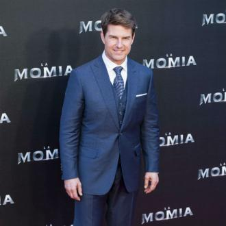 Tom Cruise surprises fans by sneaking into Tenet screening