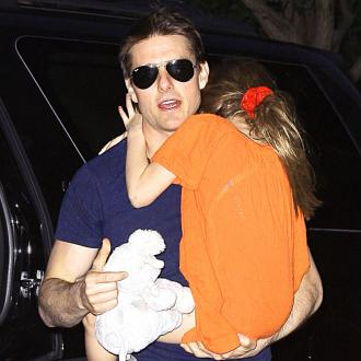 Tom Cruise Jets Suri To London For Five-day Stay