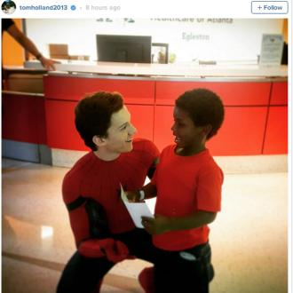 Tom Holland visits children's hospital as Spider-Man