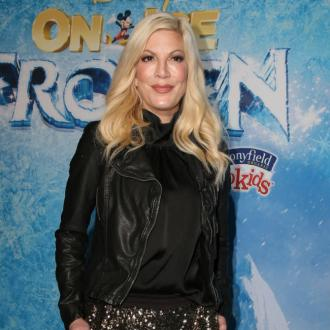 Tori Spelling role-plays as her Beverly Hills 90210 character in the bedroom