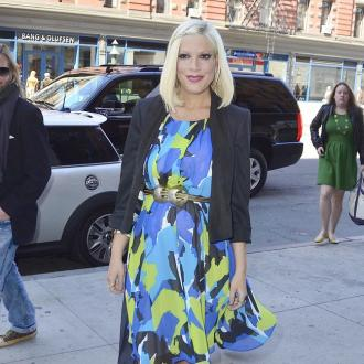 Tori Spelling's Late Dad Contacts Her With Coins