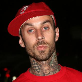 Rita Ora's new boyfriend Travis Barker still lives with ex-wife