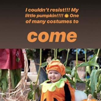 True Thompson Dresses In Sweet Pumpkin Suit On Halloween Trip