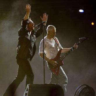 U2 show axed after Bono loses voice