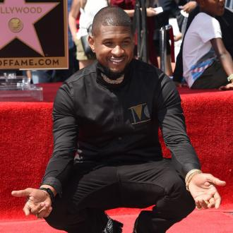 Usher missed Manchester concert to be with son