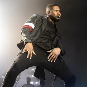 Usher denies herpes allegations