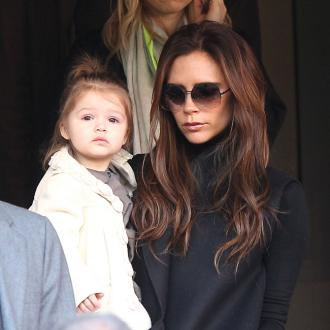 Victoria Beckham Hides Make-up Appliance From Harper