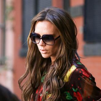 Victoria Beckham Goes Pumpkin Carving