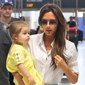 Victoria Beckham Gets Fashion Tips From Harper