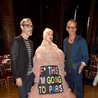 Christina Aguilera turns couture gown into political statement amid election