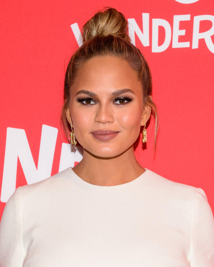 Chrissy Teigen Sparks Baby Rumours With Cookbook Tease