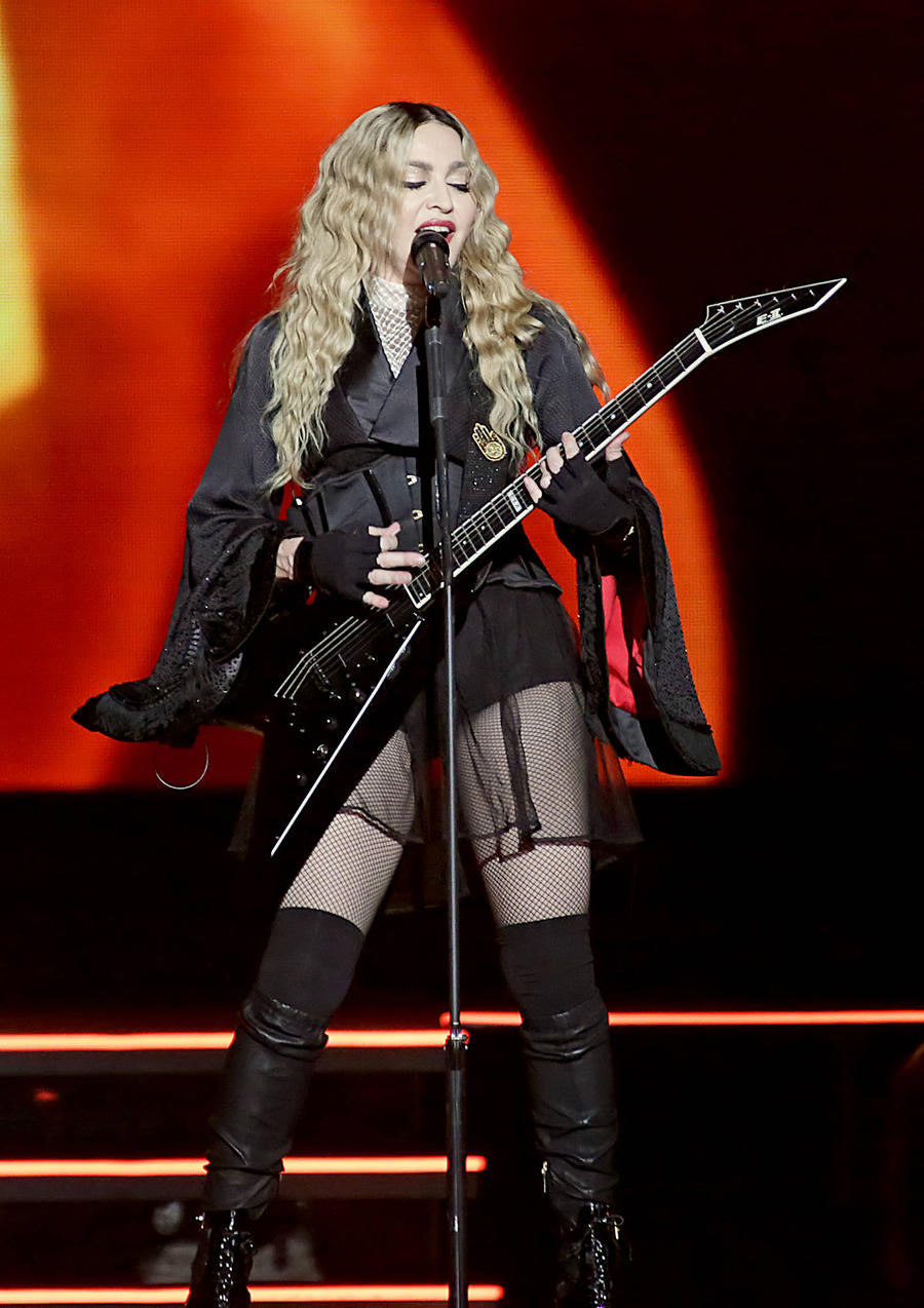 Madonna Breaks Down Onstage Amid Custody Battle