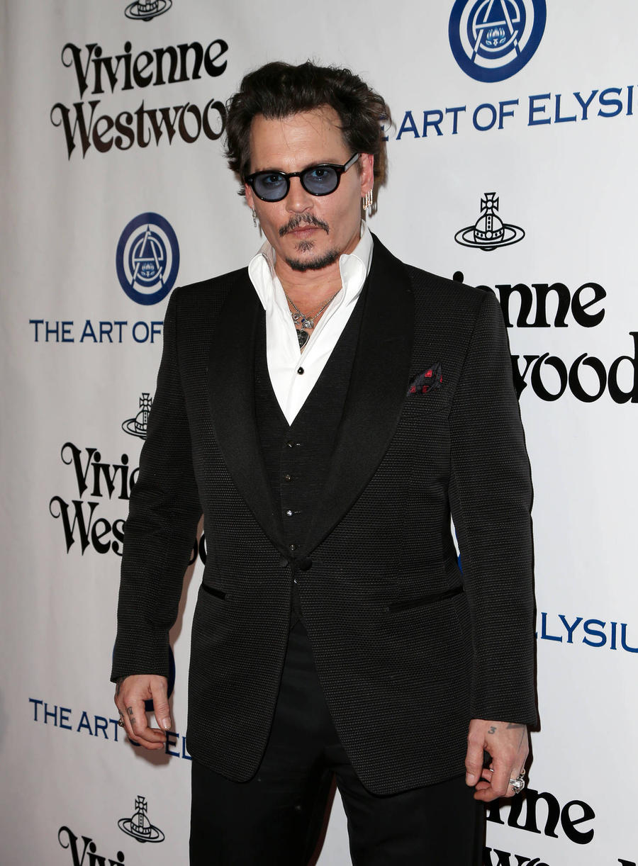 Johnny Depp Pokes Fun At Dog Immigration Drama