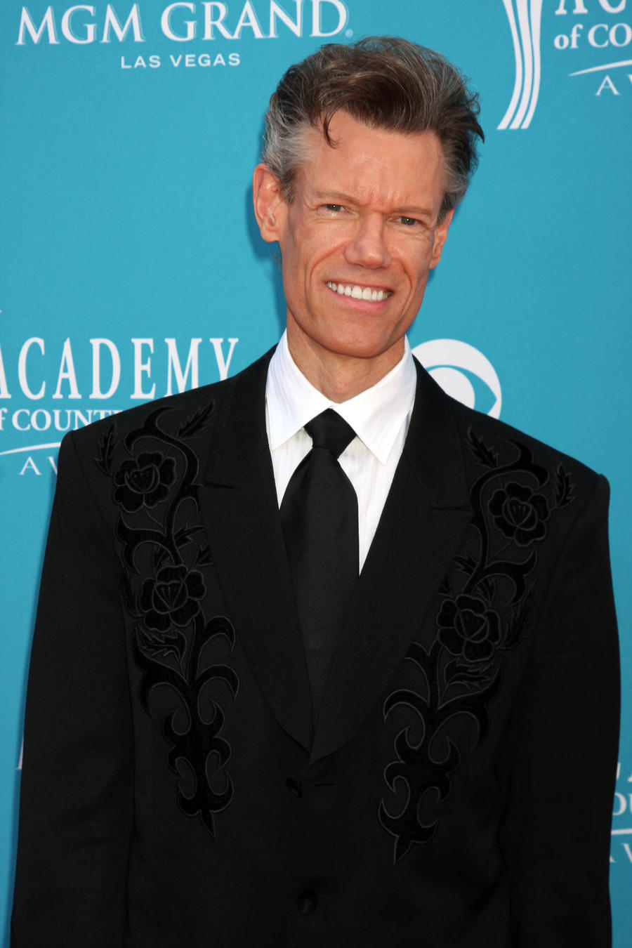 Randy Travis Surprises Police Officer With New Guitar