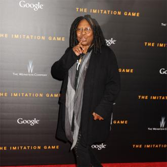 Whoopi Goldberg hands her CV to Wes Anderson