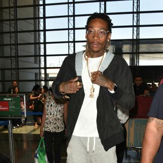 Wiz Khalifa slams critics who shamed him for letting his son ride the bus
